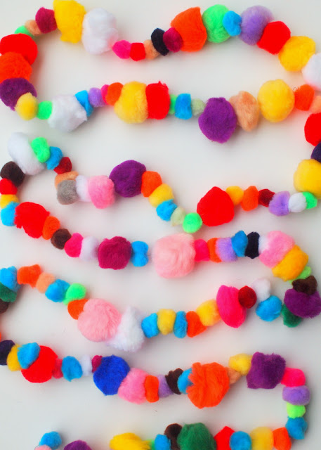 how to make a pom-pom garland- the absolute easiest craft with adorable results!