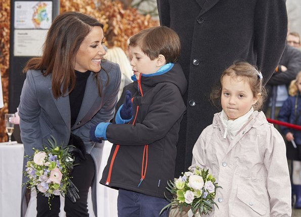 Prince Joachim, Princess Marie and their children Princess Athena and Prince Henrik attend opening of the Bakken amusement park in Klampenborg. Princess Marie wore Ralph Lauren wool coat