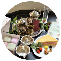 cafe tearoom tuff tray with silver teapot, plastic champagne glass, fondant famcies and macarons