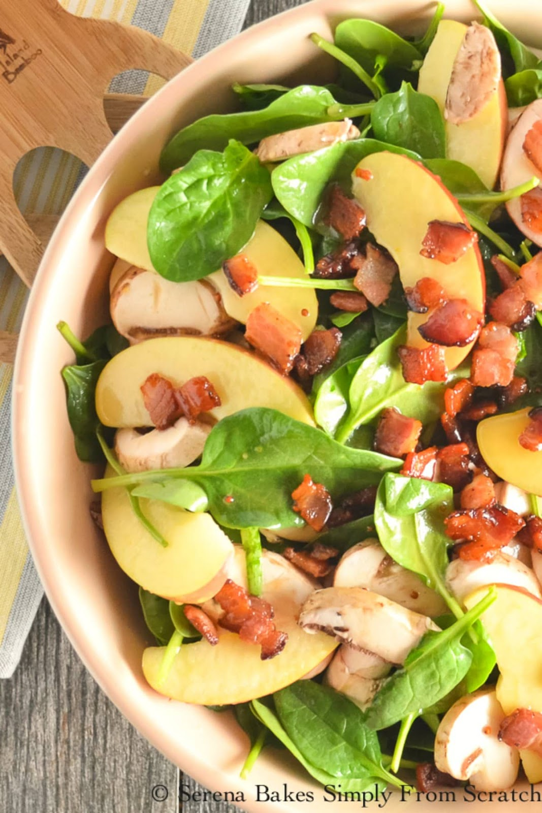 Spinach Salad with Bacon and Apples drizzled with Homemade Honey Mustard Dressing recipe is a favorite salad from Serena Bakes Simply From Scratch.