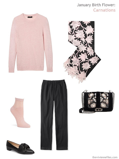 wearing a carnation pink sweater with black
