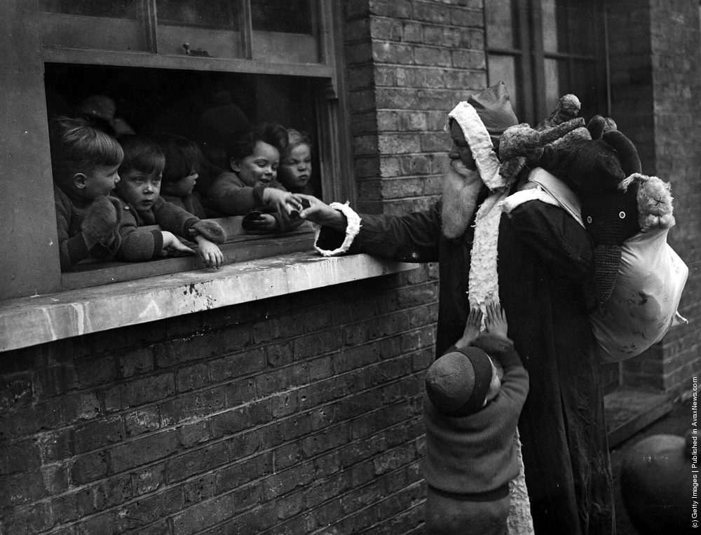 Father Christmas Delivering Presents To The Childrens Aid And Adoption Society At Leytonstone London 20th November 1931 Photo By Fox Photos Getty
