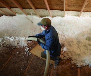 Blown-in insulation being installed in an attic