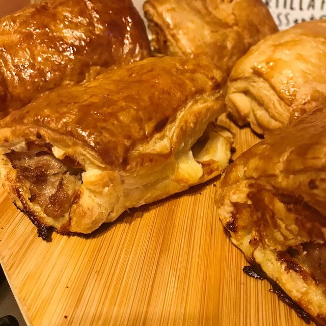 Sausage rolls on chopping board