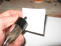 Insert the tube center insulator into the template hole