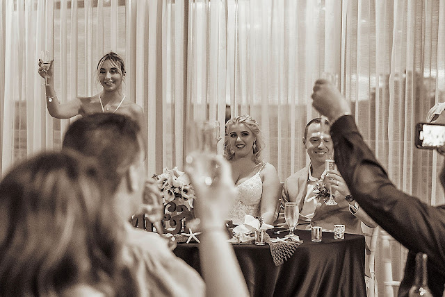 Toast by sweetheart table Hutchinson Island Wedding Photography captured by South Florida Wedding Photographer Houghton Photography