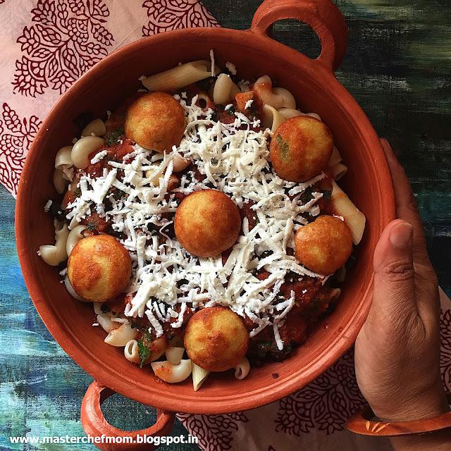 Indian Rasam Sauce Pasta with Paniyaram Balls