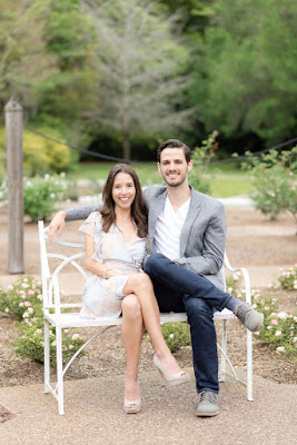 couple smiling on white bench