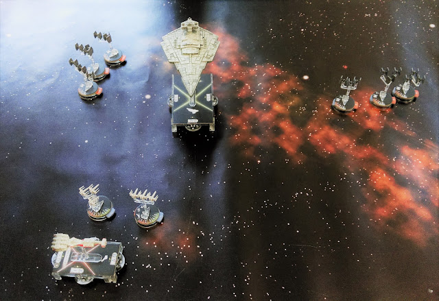 Victory class Imperial Star Destroyer and Tie Squadrons approach the Rebel Alliance fleet