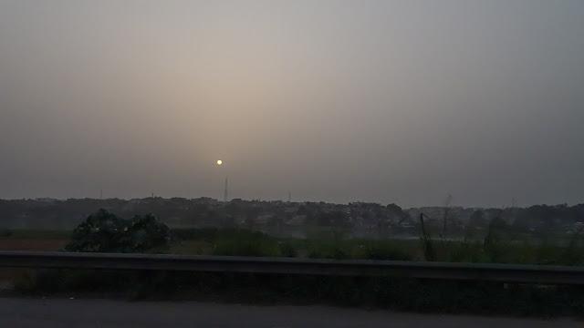 The haze blocks the sun and looks like moon