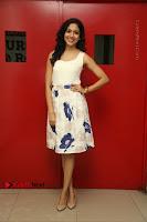 Actress Ritu Varma Stills in White Floral Short Dress at Kesava Movie Success Meet .COM 0142.JPG