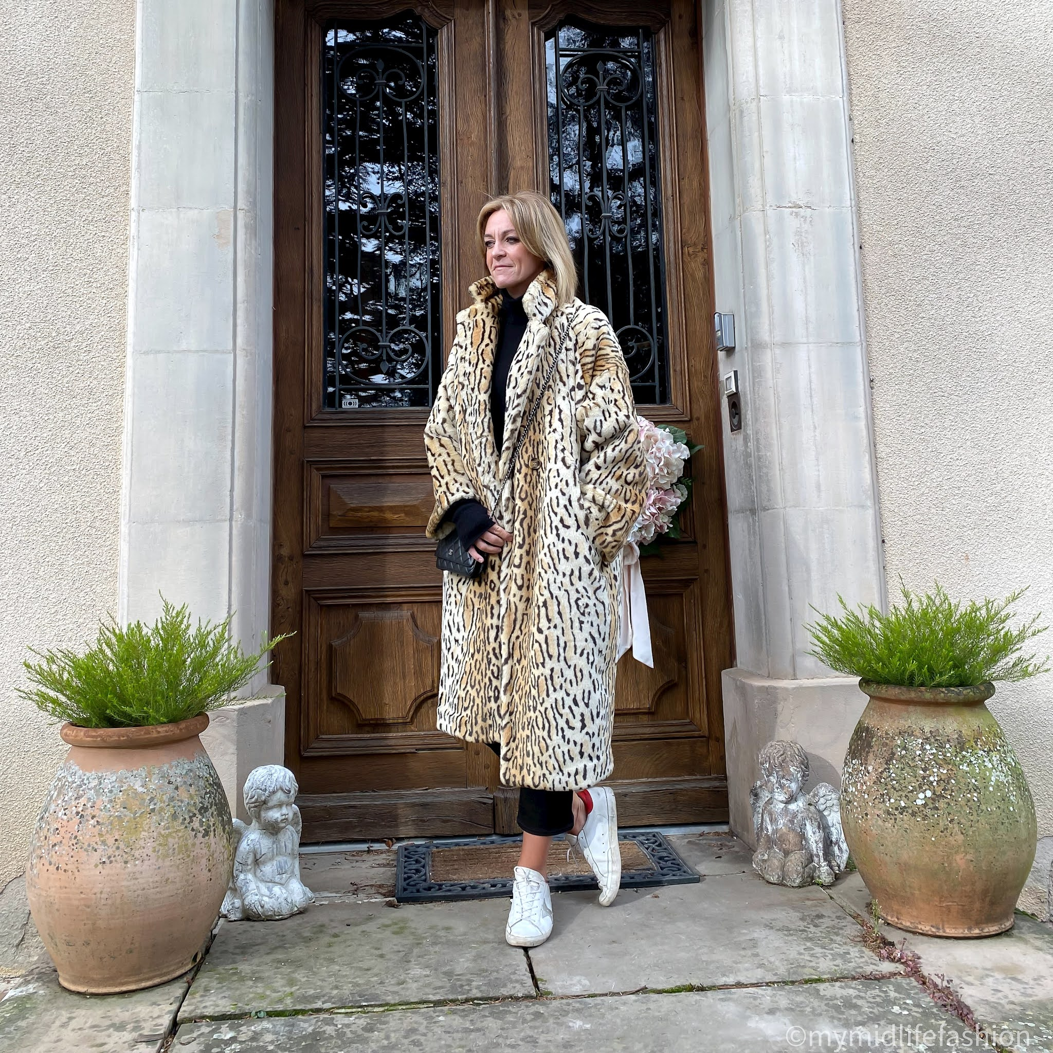 my midlife fashion, marks and Spencer pure cashmere roll neck jumper, j crew cropped kick flare jeans, golden goose superstar low top leather trainers, hush cashmere wrist warmers, h and m leopard print faux fur coat