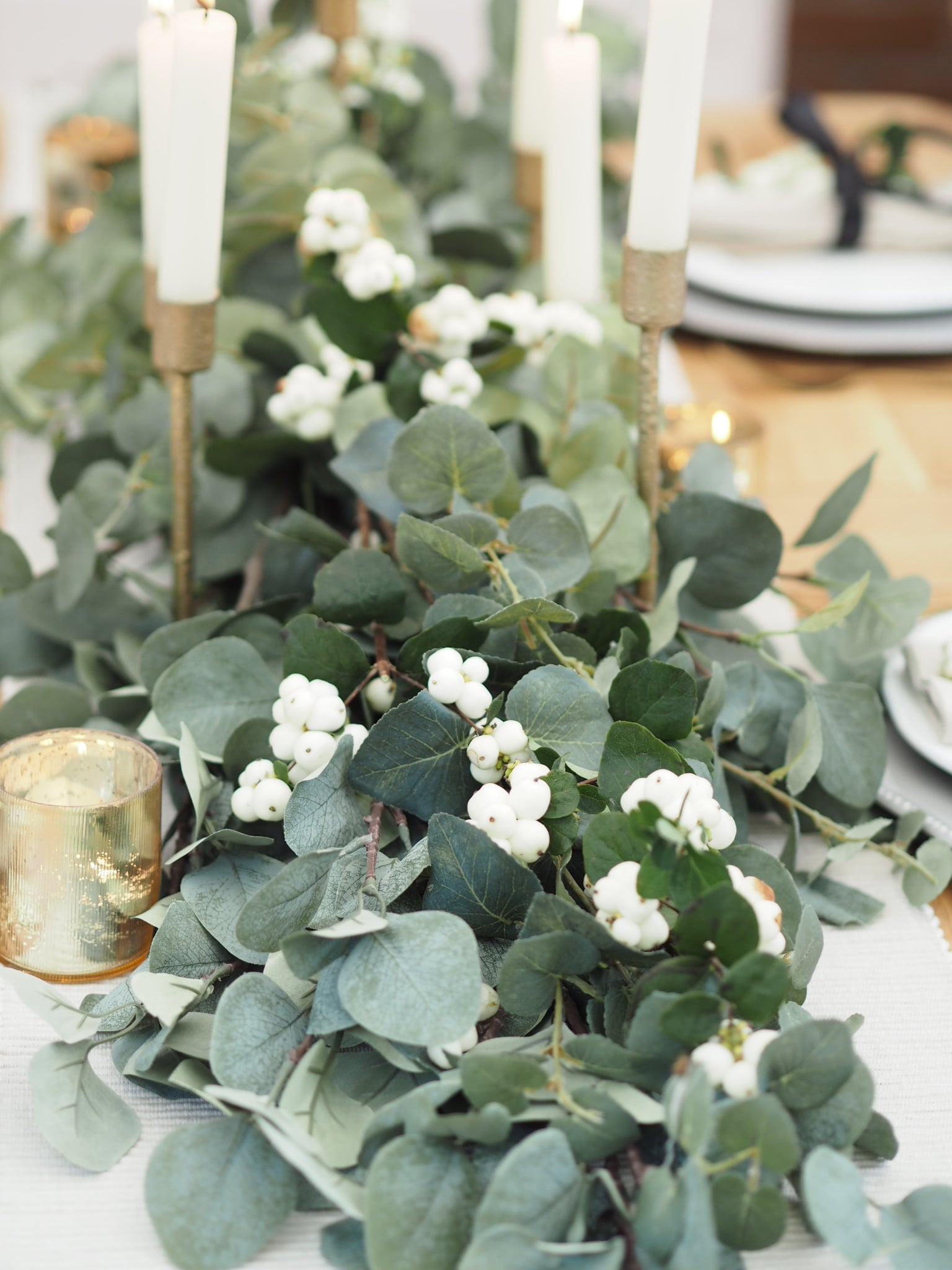 Christmas dining table decor, how to create a garland from faux eucalyptus stems to DIY a budget show-stopping display at home for your Christmas meal