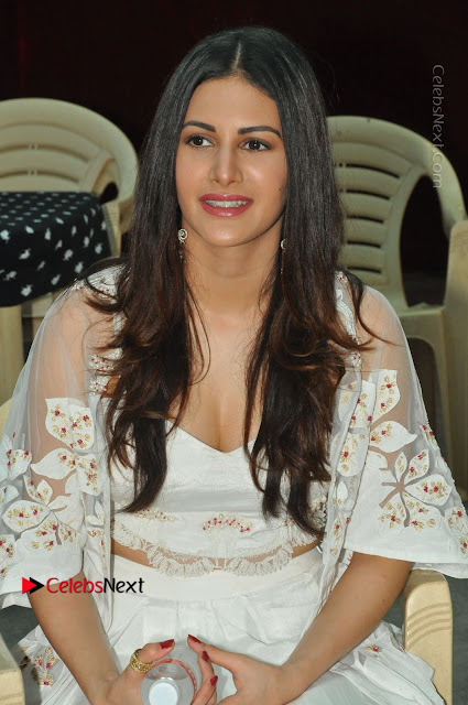 Telugu Actress Amyra Dastur Stills in White Skirt and Blouse at Anandi Indira Production LLP Production no 1 Opening  0001