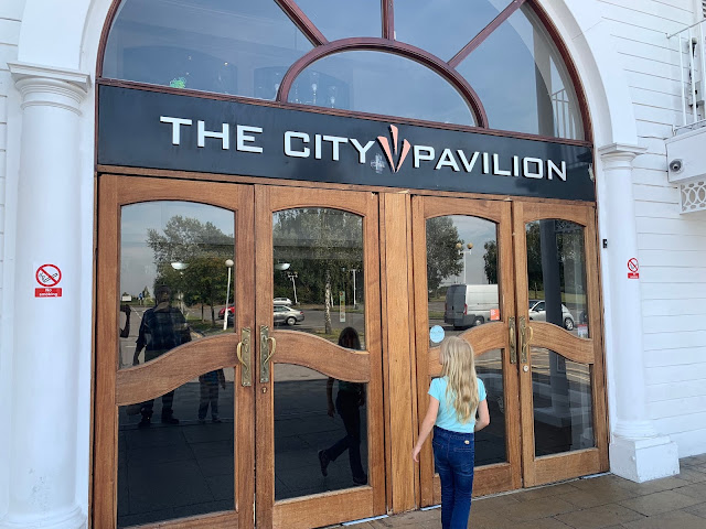 Girl walking towards the entrance of the City Pavilion, Romford
