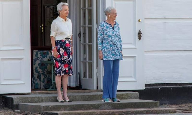 Princess Benedikte wore a floral print skirt and silk top. This Friday's changing of the guards was attended by the Queen and Princess Benedikte