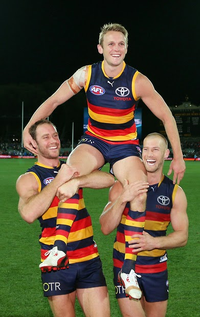 Brent Reilly of the Crows is chaired off after his 200th game by Ben Rutten & Scott Thompson.(Source: AFL Media)