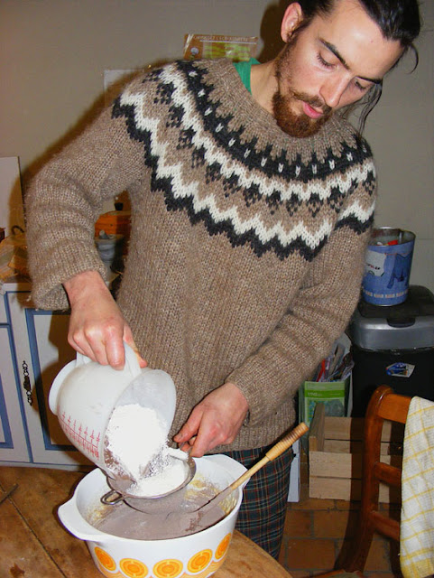 Sifting flour and cocoa into cake batter.  Indre et Loire, France. Photographed by Susan Walter. Tour the Loire Valley with a classic car and a private guide.