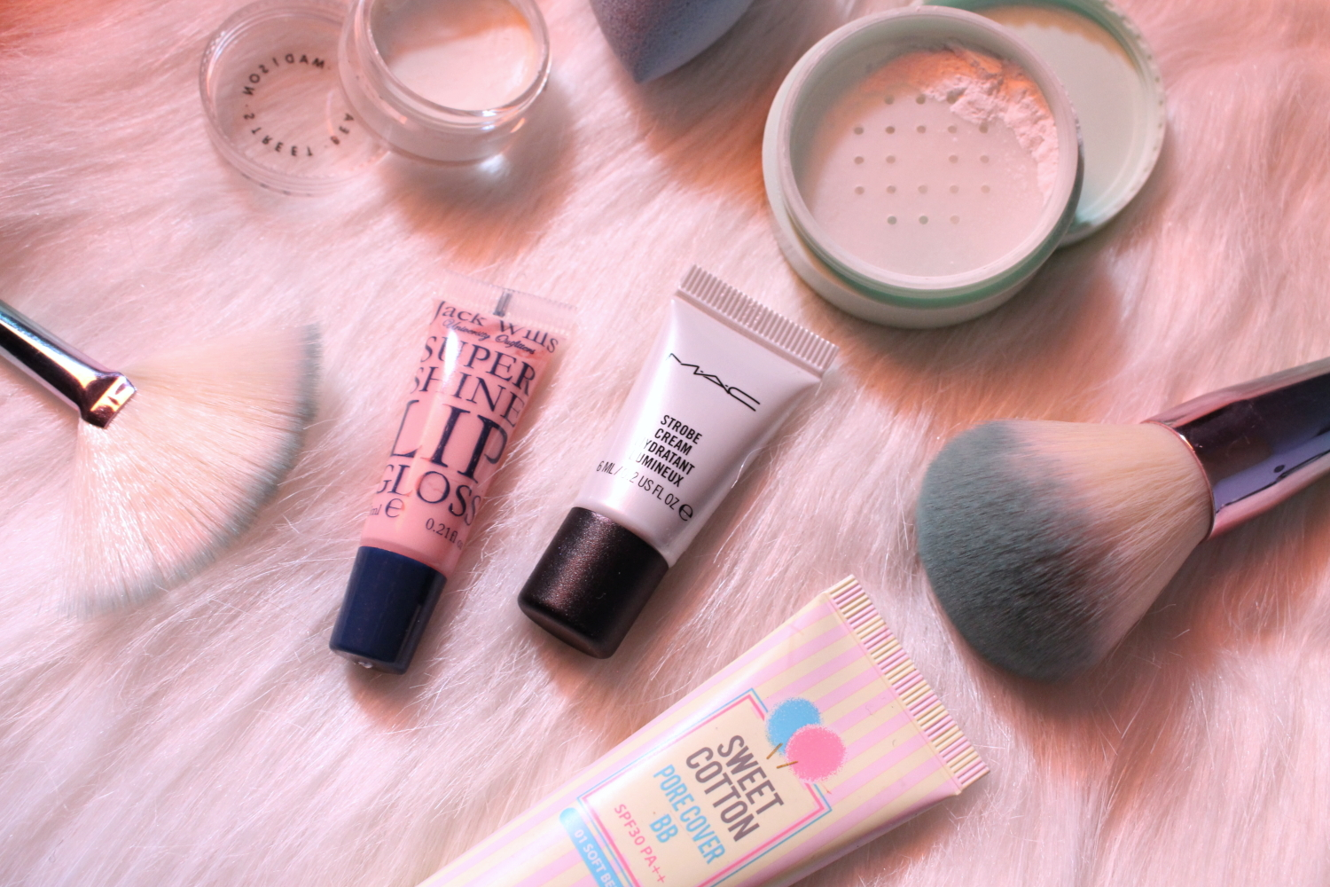 photo of pastel makeup flatlay