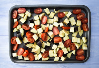 grilled aubergine and tomatoes on baking tray