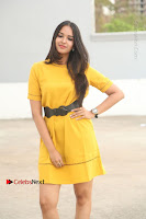 Actress Poojitha Stills in Yellow Short Dress at Darshakudu Movie Teaser Launch .COM 0034.JPG