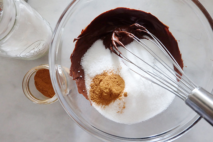 melted chocolate with sugar and cinnamon in a bowl