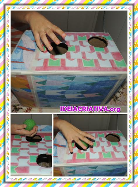 Caixa decorada com obras de Volpi para trabalhar Habilidades Motoras e socialização com bebês