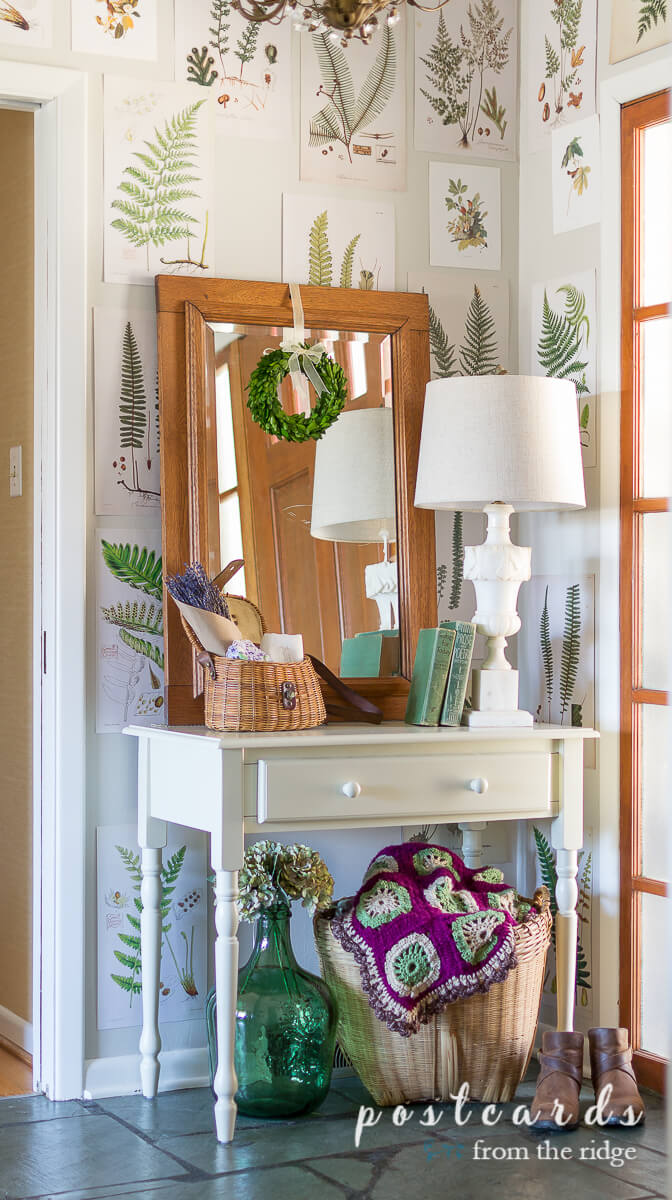entry with fern botanicals on wall