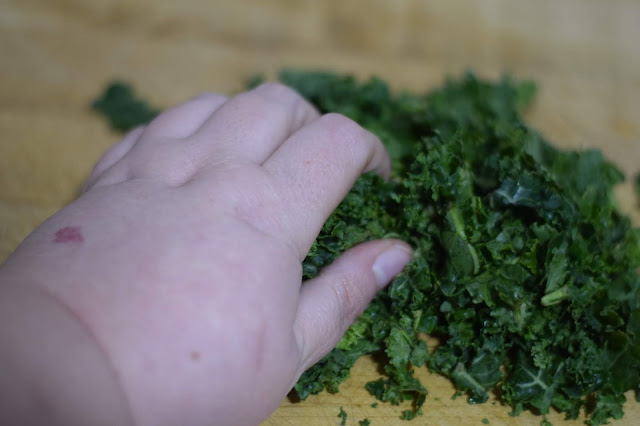 Kale being massaged on the counter.