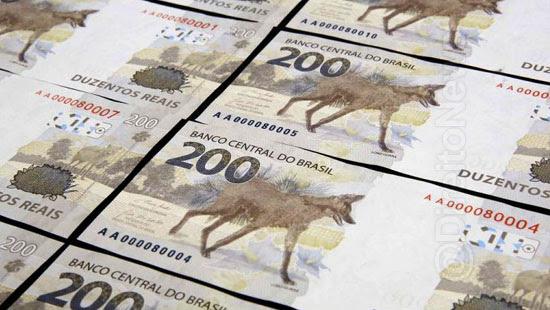 dinheiro mao vendaval nota 200 criminalidade