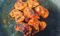 Roasting  crisp golden chicken pieces on Non stick pan for butter chicken Murgh makhani recipe
