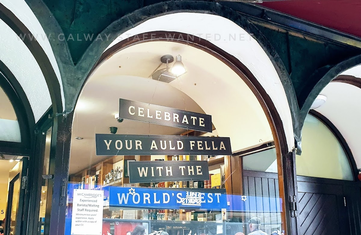 Job ad in a high-arch shop-window in an Irish main street, backed but a sign marking Father's Day with the instruction to celebrate your auld fella with the world's best - presumably the world's best whiskey