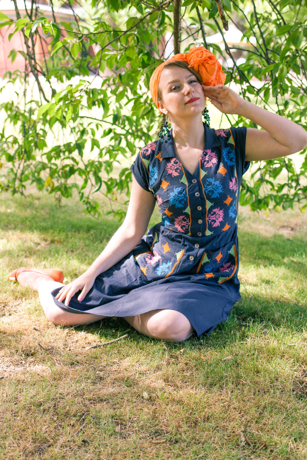 @findingfemme wears Lazybones cross stitched dress with orange scarf.