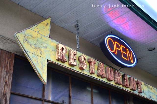 Rusty junk arrow restaurant sign at Mission Springs Brewing Company, a junk-filled pub and restaurant.