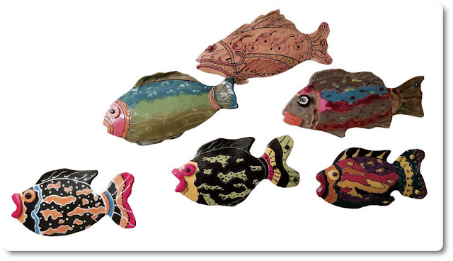 School of fish ceramic art hanging on the wall