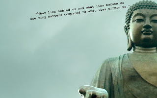 HD wallpaper of Buddha meditating with quote lines