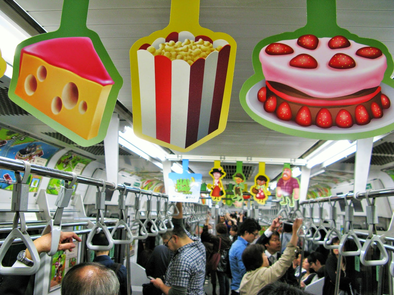 Colorful advertising in a Yamanote line train, Tokyo.