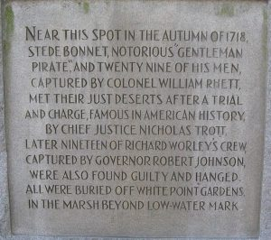 Close up of an old plaque in White Point Garden, Charleston, commemorating the hanging of Stede Bonnet and 29 other pirates