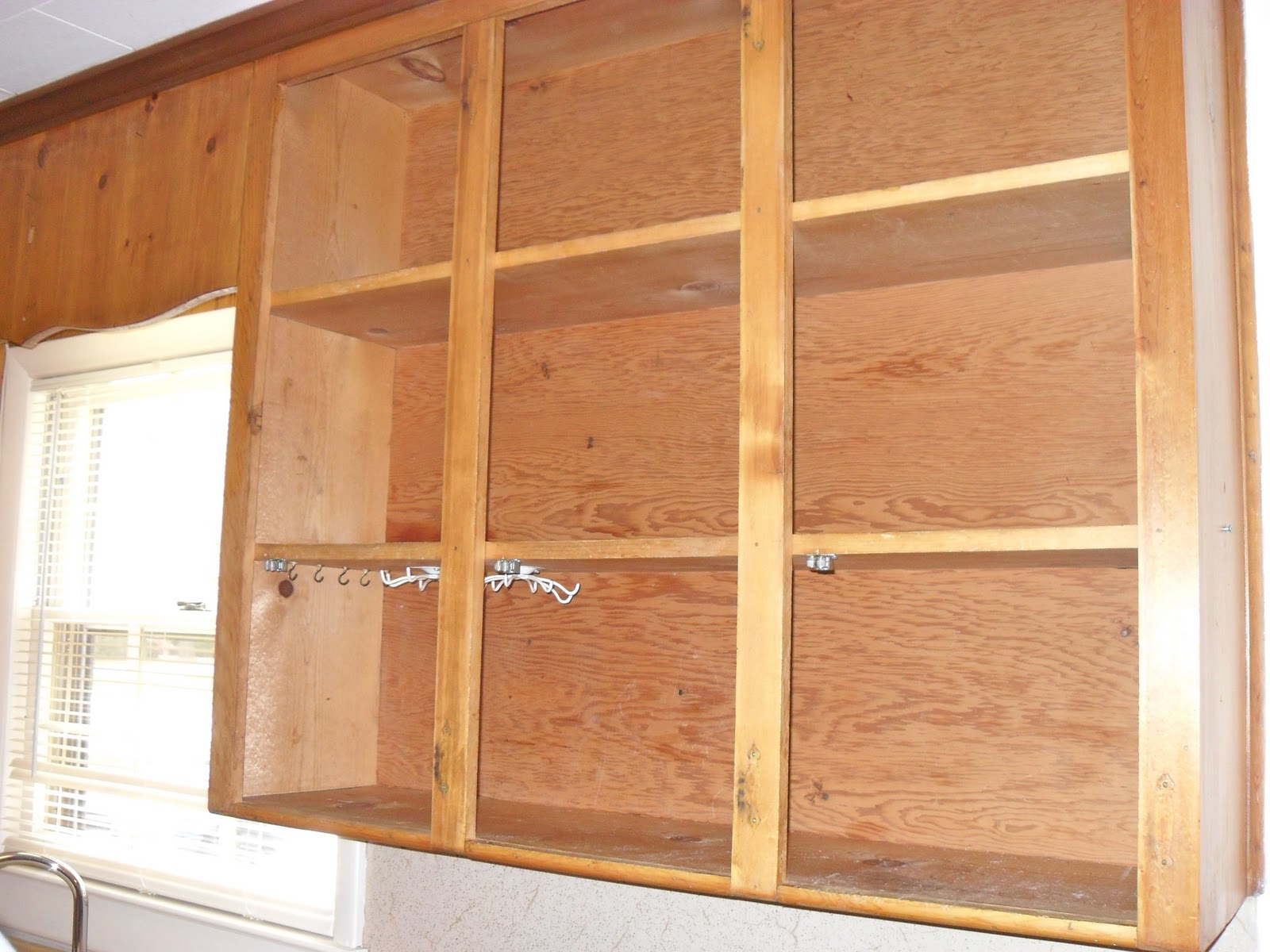diy painting knotty pine cabinets pine cabinets kitchen DIY Painting Knotty Pine Cabinets