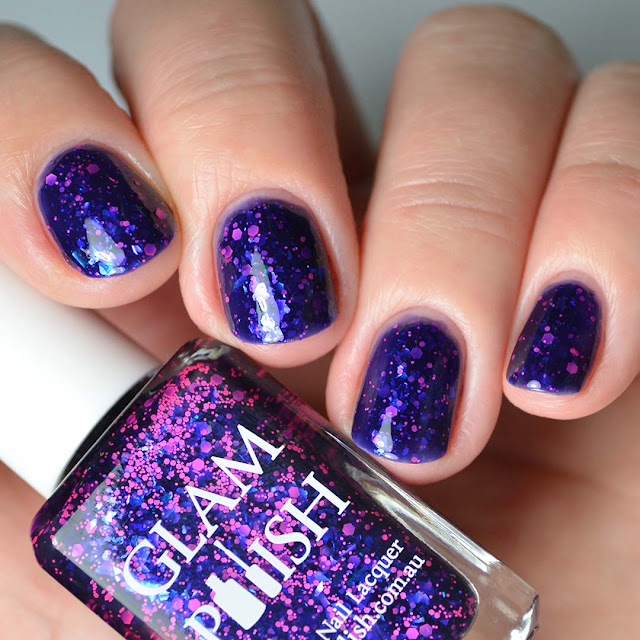 blue nail polish with pink glitter four finger swatch