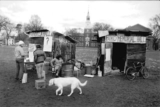 A black and white photograph of the campus shanty town.