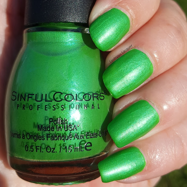 Grass green neon nail polish with bright green shimmer.