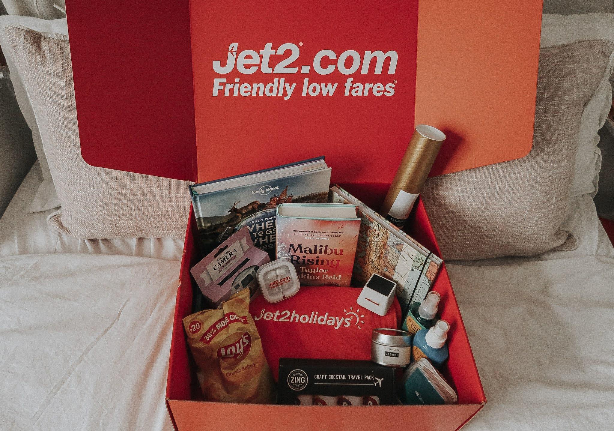 A red Jet2.com box with travel essentials.