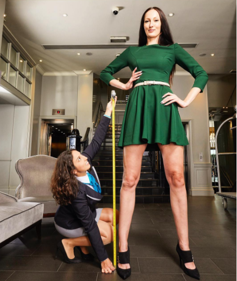 Adorable Photos Of Ekaterina Lisina: The Tallest Woman In The World