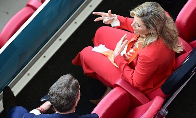 King Willem-Alexander and Queen Maxima attended the UEFA 2020 football match. Massimo Dutti orange suit, Natan, Zara red blazer