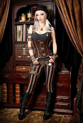 An example of underbust corsets in Steampunk women's fashion. Kato is wearing her underbust corset with pants, a tank top, boots and a bowler hat.