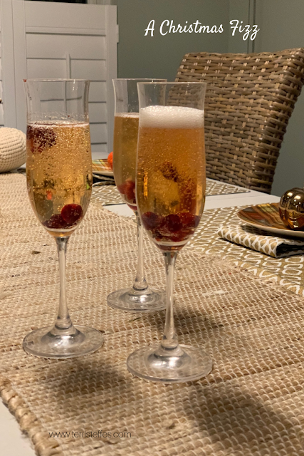 A Christmas Fizz, a cocktail using brandied cranberries and prosecco.
