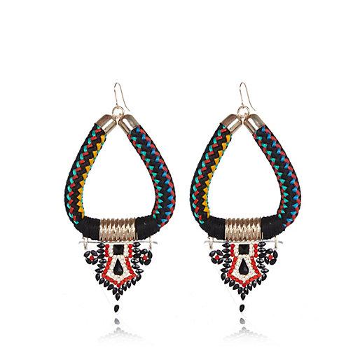 http://www.riverisland.com/women/jewellery/earrings/Black-woven-tribal-dangle-earrings-650239