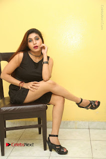Tollywood Upcoming Actress Pooja Roshan Stills in Black Short Dress at Plus 1 Movie Trailer Launch  0311.JPG