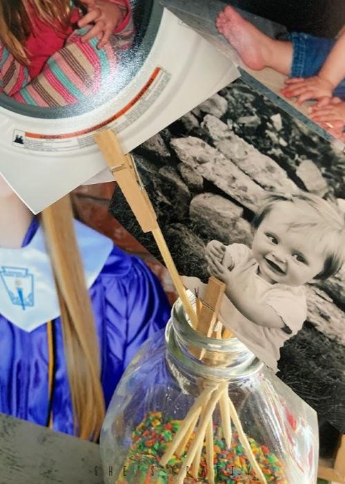 graduation display at home  -  rainbow rice jar filler, photo display, photo clips